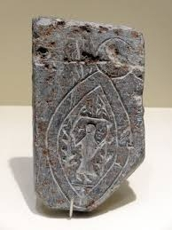 An example of a stone mould for a pilgrim's badge.